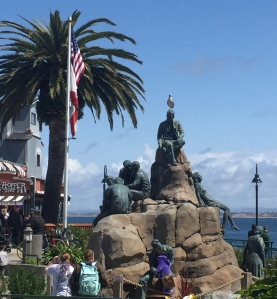 The Cannery Row Monument in Monterey, California. The monument features california author John Steinbeck alongside other local legends. It's location on Cannery Row is easy to access and worth visiting on your California road trip.